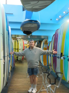 Yours truly, standing amongst the surf boards at the Ron Jon Surf Shop in Cocoa Beach, Florida.
