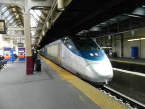 Amtrak's Acela Express features Business and First Class accommodations, including foot rests and reclining seats.