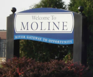 Moline, Illinois is nearly three hour drive west of Chicago (165 miles).
