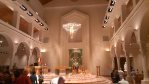 Here, congregation at the Basilica of The National Shrine of Mary, Queen of The Universe assembles for Saturday night mass. Masses are offered on Saturdays at 6 pm, and on Sundays at 7:30 am, 9:30 am, 11:30 am, and 6 pm.
