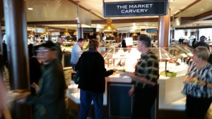 Having boarded the ship, cruise passengers can enjoy the never-ending array of food choices. Here, cruise passengers enjoy lunch in the Windjammer Marketplace aboard the Anthem of The Seas.
